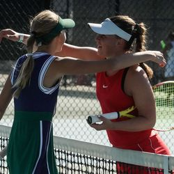 Bailey Huebner, of Green Canyon, left, and Erika Olsen, of Bear River, shares a hug after the first final singles match of the 4A girls tennis state tournament at Liberty Park Tennis Center in Salt Lake City on Saturday, Oct. 2, 2021. Bailey won the match.