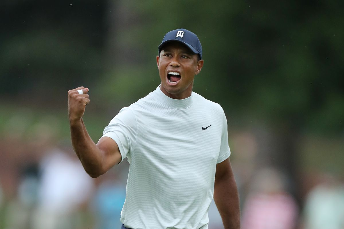 8dda2bbc Tiger Woods and his mock turtleneck are back in contention at the Masters