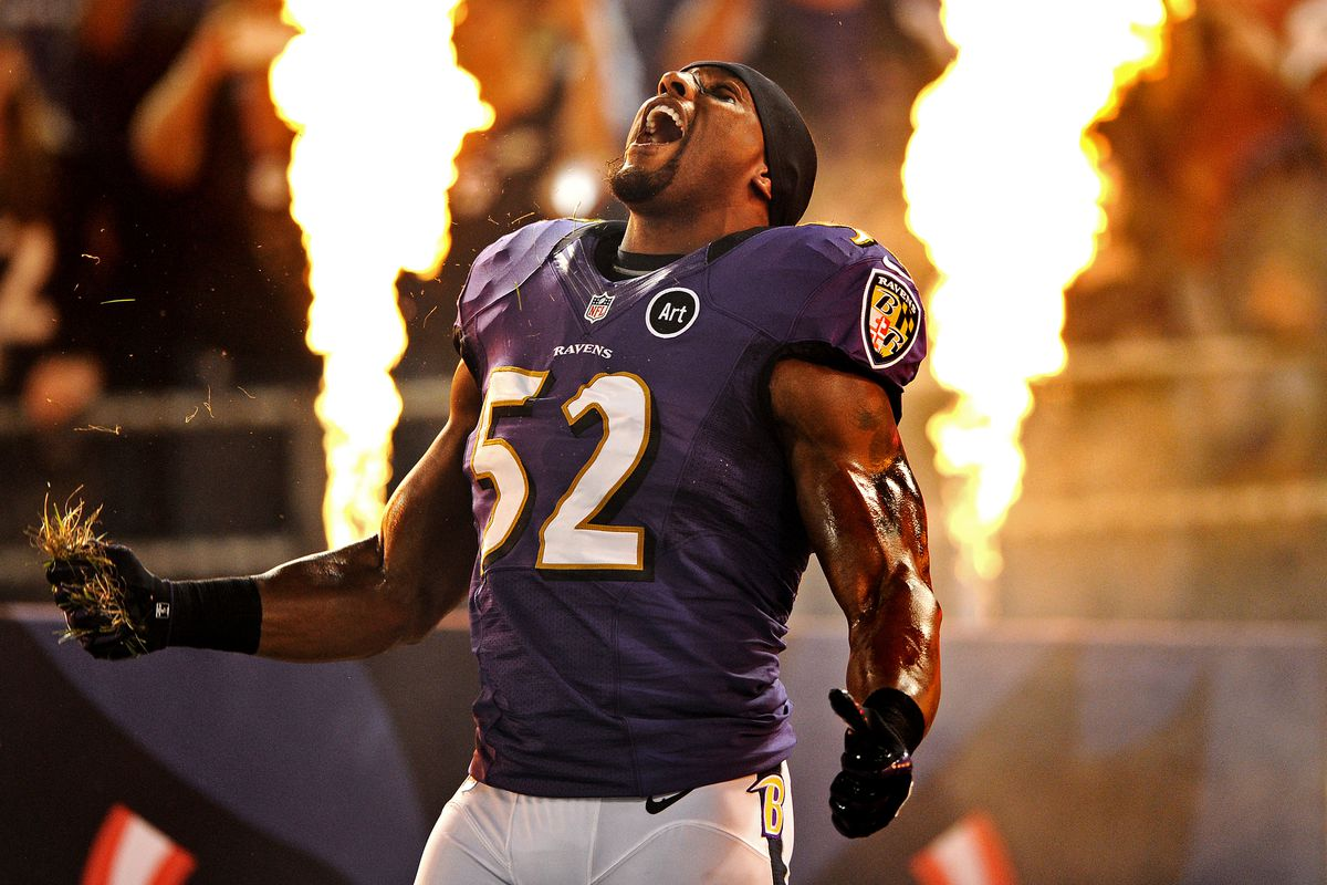 Ray Lewis has very shiny arms.