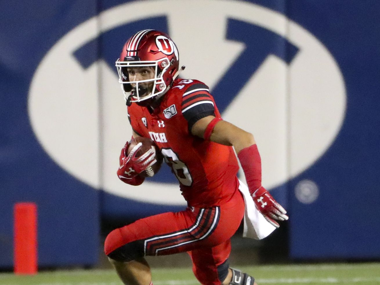 Utah's Britain Covey (18) heads upfield after fielding a punt during the Utah-BYU football game at LaVell Edwards Stadium in Provo on Thursday, Aug. 29, 2019.