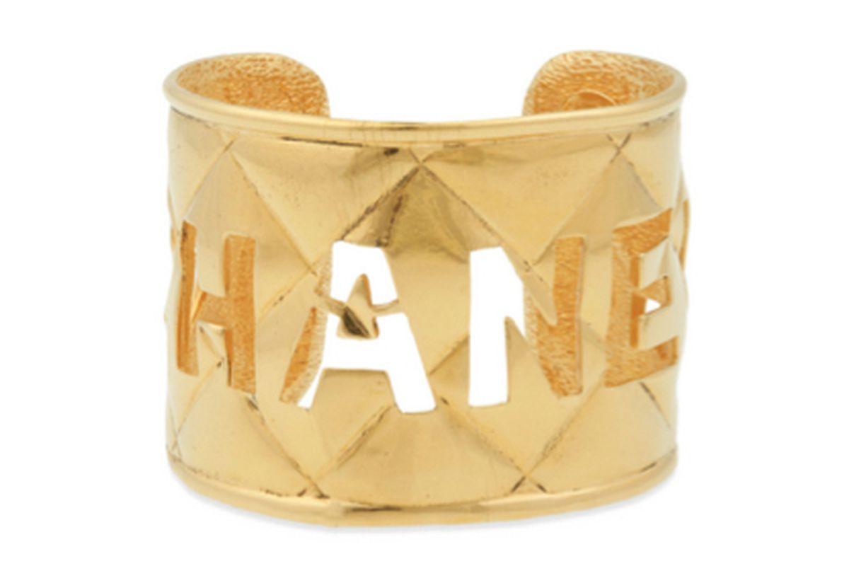 "Image via <a href=""http://www.renttherunway.com/shop/designers/bracelets_jewelry/vintagechanelruecuff"">Rent the Runway</a>"