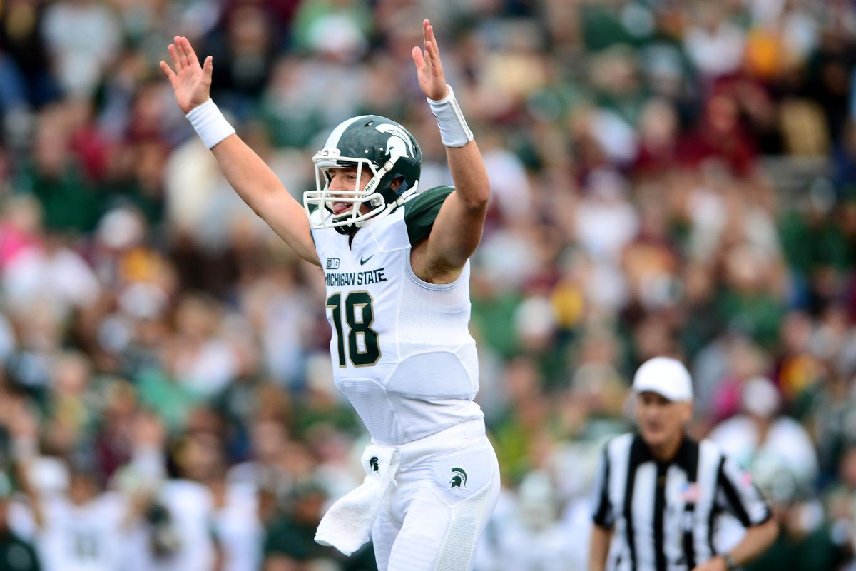 Sep 8, 2012; Mt. Pleasant, MI, USA; Michigan State Spartans quarterback Connor Cook (18) celebrates a touchdown in the fourth quarter against the Central Michigan Chippewas at Kelly/Shorts Stadium. Mandatory Credit: Andrew Weber-US Presswire