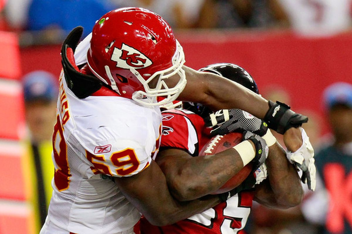 ATLANTA - AUGUST 13:  Antone Smith #35 of the Atlanta Falcons is tackled by Jovan Belcher #59 of the Kansas City Chiefs at Georgia Dome on August 13 2010 in Atlanta Georgia.  (Photo by Kevin C. Cox/Getty Images)