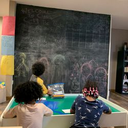 Ayden looks at a chalkboard with his family.
