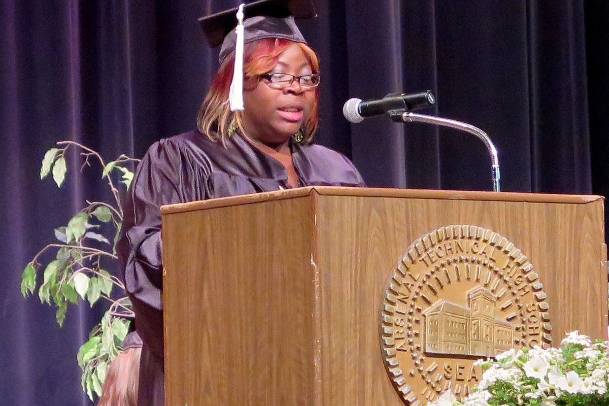Carmellia Fleming gives a graduation speech at Indianapolis Public Schools' adult basic education ceremony. The district's programs will soon be taken over by nearby townships.