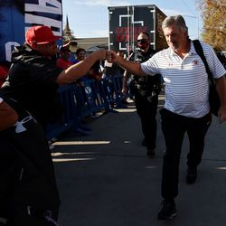 Utah Utes head coach Kyle Whittingham greets a fan as the team arrives for a game against BYU at LaVell Edwards Stadium in Provo on Saturday, Sept. 11, 2021.