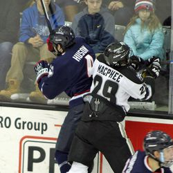 UConn's Kyle Huson (4) is checked in to the boards by Providence's Conor McPhee (29)
