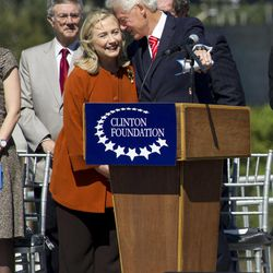Former President Bill Clinton, right,  talks to his wife Secretary of State Hillary Rodham Clinton, left, before making an address dedicating a new pedestrian bridge located next to his presidential library in Little Rock, Ark. Friday Sept. 30, 2011.
