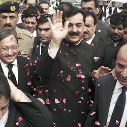 Pakistani Prime Minister Yousuf Raza Gilani, center, makes his way to the Supreme Court for a hearing in Islamabad, Pakistan, Thursday, April 26, 2012.  The Supreme Court convicted Gilani of contempt on Thursday for refusing to reopen an old corruption case against President Asif Ali Zardari on Thursday, but spared him a prison term in a case that has stoked political tensions in the country. (AP Photo/B.K. Bangash)