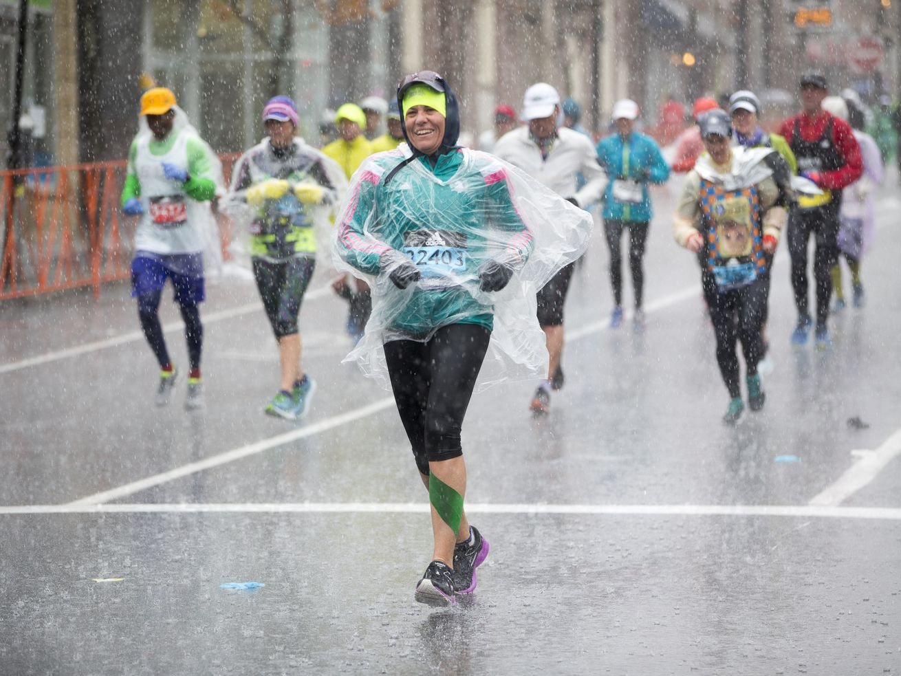 Runners approach the 24-mile marker of the Boston Marathon in heavy rain on April 16, 2018.