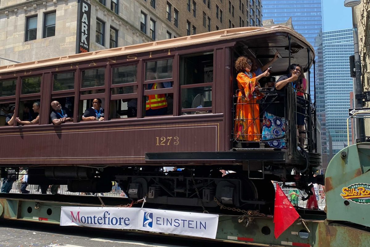 Essential workers make their way up the Canyon of Heroes in an vintage subway car, July 7, 2021.