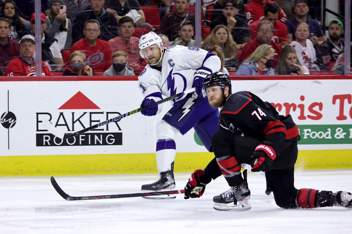 Steven Stamkos #91 of the Tampa Bay Lightning shoots the puck past the defense of Jaccob Slavin #74 of the Carolina Hurricanes in Game Two of the Second Round of the 2021 Stanley Cup Playoffs against the Carolina Hurricanes on June 1, 2021 at PNC Arena in Raleigh, North Carolina.