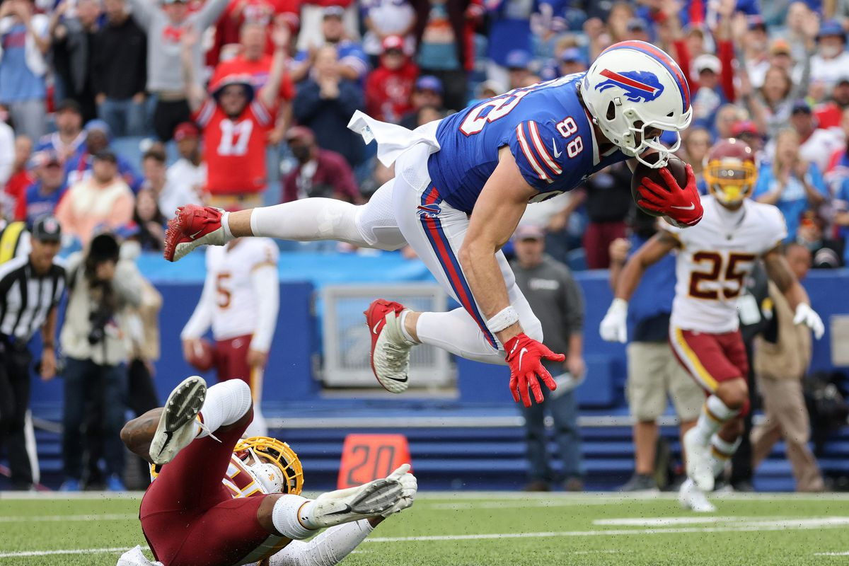 Bills tight end Dawson Knox goes airborne for extra yards after a catch.
