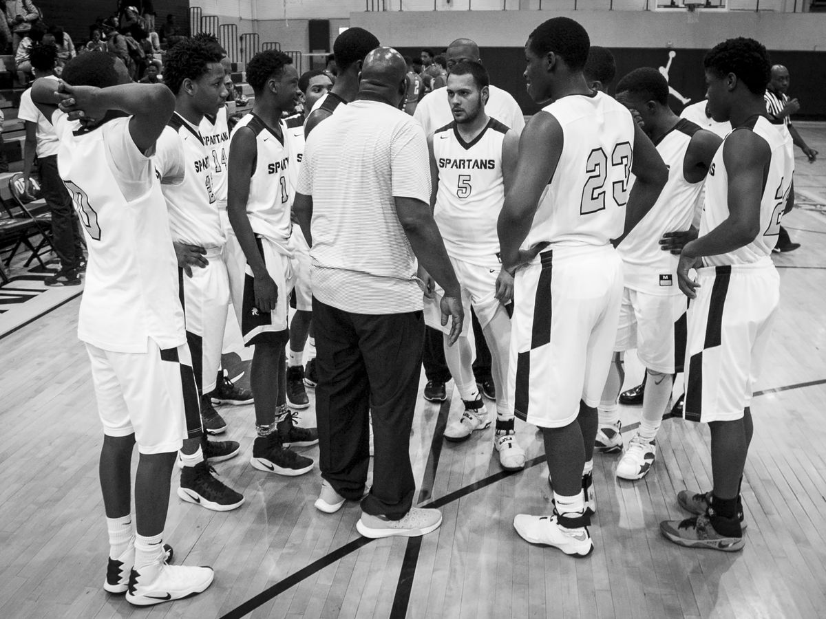 Coach Lou Adams talks to his players during a timeout against Westinghouse College Prep at Orr Academy High School, Jan. 11, 2017.