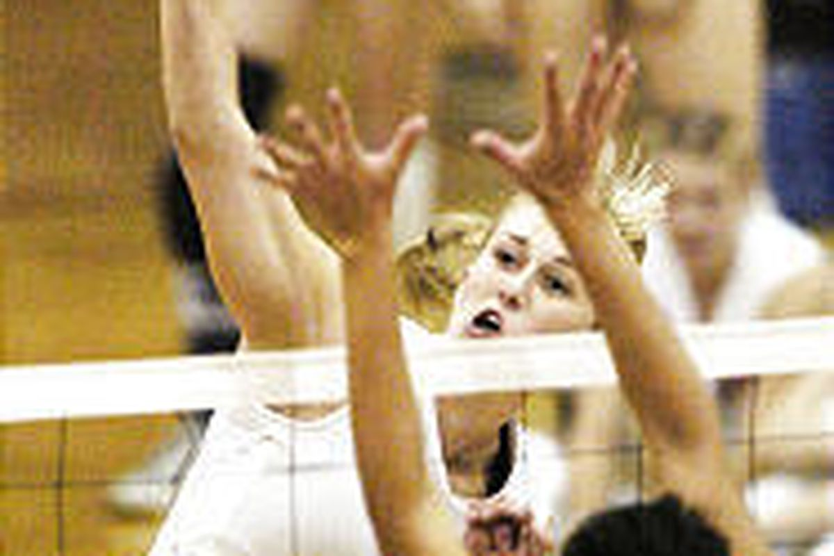 Brighton's team leader Krista Kelley slams the ball past the defense of Pleasant Grove's Whitney Mendivil in the recent gold match of the Tournament of Champions at Skyline High School. Brighton won the match.