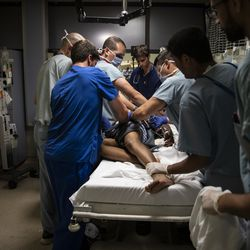 Medical personnel perform their duties from specific positions around the bed while treating a man suffering from a stab wound in the Emergency Department at Mount Sinai Hospital, Tuesday evening, Sept. 10, 2019.