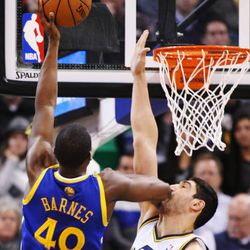 Utah Jazz center Enes Kanter (0) gets an elbow in the nose by Golden State Warriors small forward Harrison Barnes (40) during NBA action in Salt Lake City  Friday, Jan. 31, 2014.