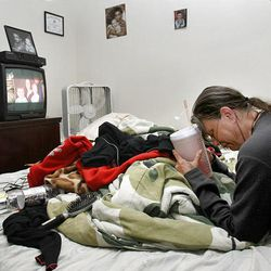 Ruth Serrano of South Ogden becomes emotional as she watches a report on the death of her son, Kurt Curtiss.