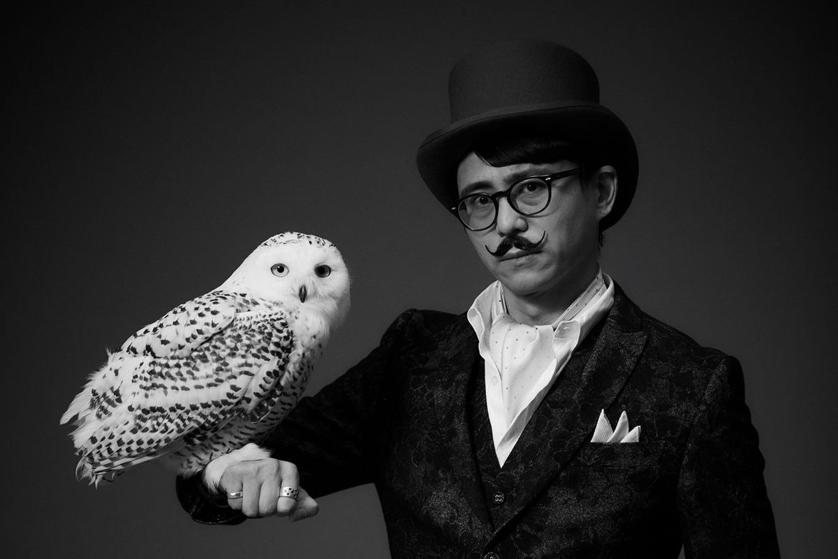 Publicity photos featuring Swery in a top hat and sporting a handlebar mustache. A white owl is perched on his forearm.
