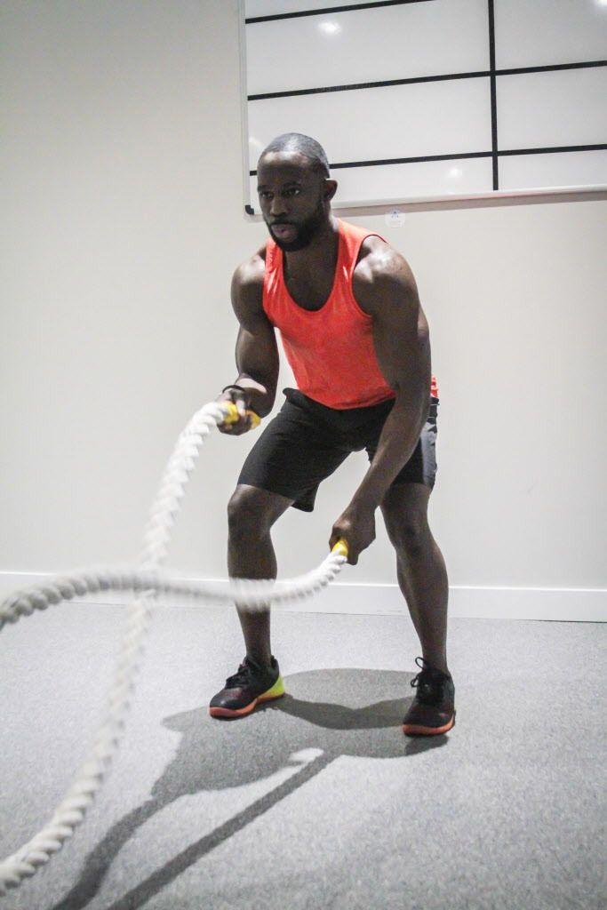 Gideon Akande executes the battle rope waves.   Maria Cardona/ Sun-Times