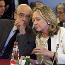 Secretary of State Hillary Rodham Clinton speaks with France's Foreign Minister Alain Juppe during a meeting on Syria, Thursday, April 19, 2012, in Paris.