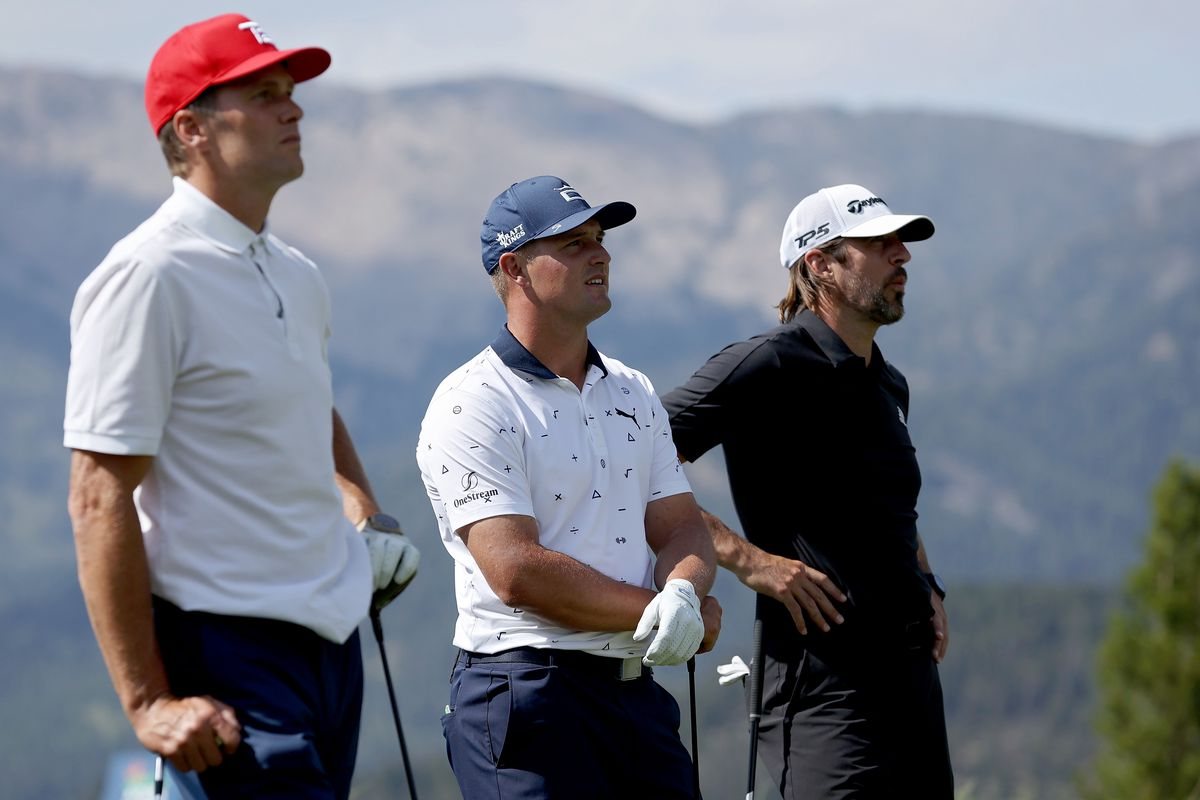Tom Brady, Bryson DeChambeau, and Aaron Rodgers look on during Capital One's The Match at The Reserve at Moonlight Basin on July 06, 2021 in Big Sky, Montana.