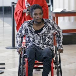 """Abdullahi """"Abdi"""" Mohamed, a Somali refugee, who was shot and critically wounded by police last February, arrives at the Matheson Courthouse, Friday, June 23, 2017, in Salt Lake City. Mohamed will be fined $500 after agreeing to a plea deal in what prosecutors call a failed drug deal and assault just before the February 2016 shooting."""