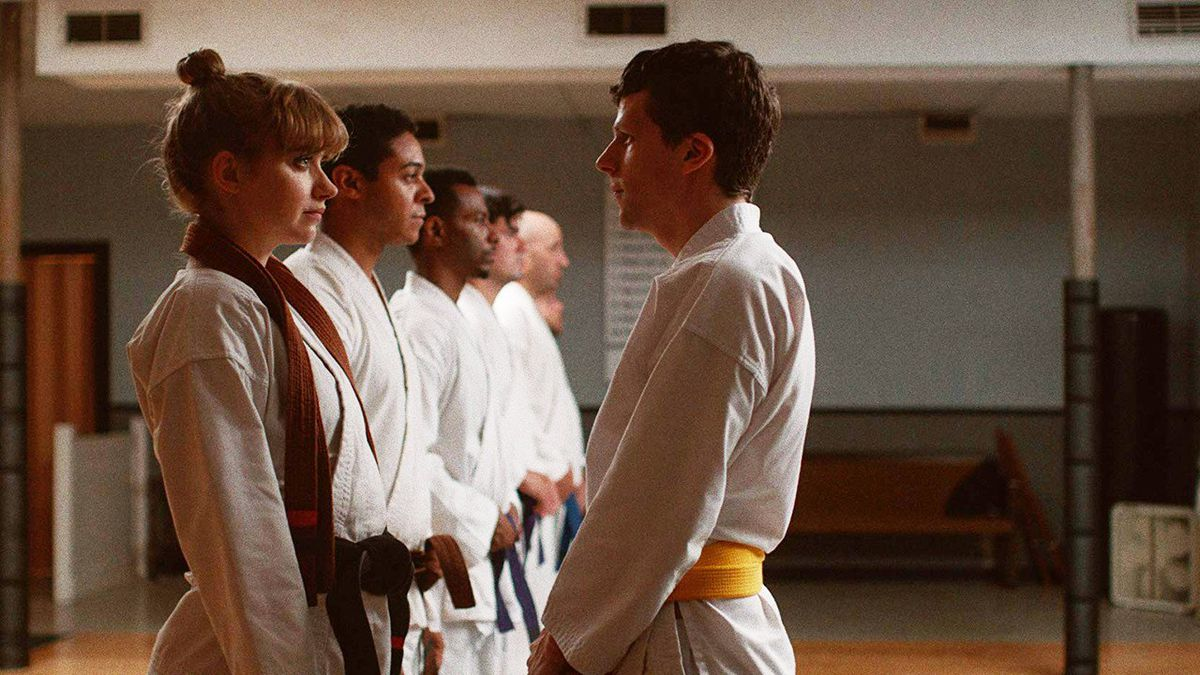 Casey (Jesse Eisenberg) stands toe to toe with a female student at the dojo in The Art of Self-Defense