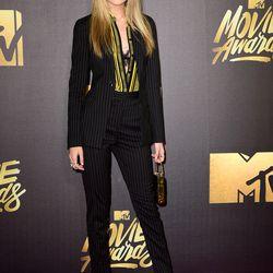 Gigi Hadid wears a Versace pantsuit and (maybe fake) bangs.