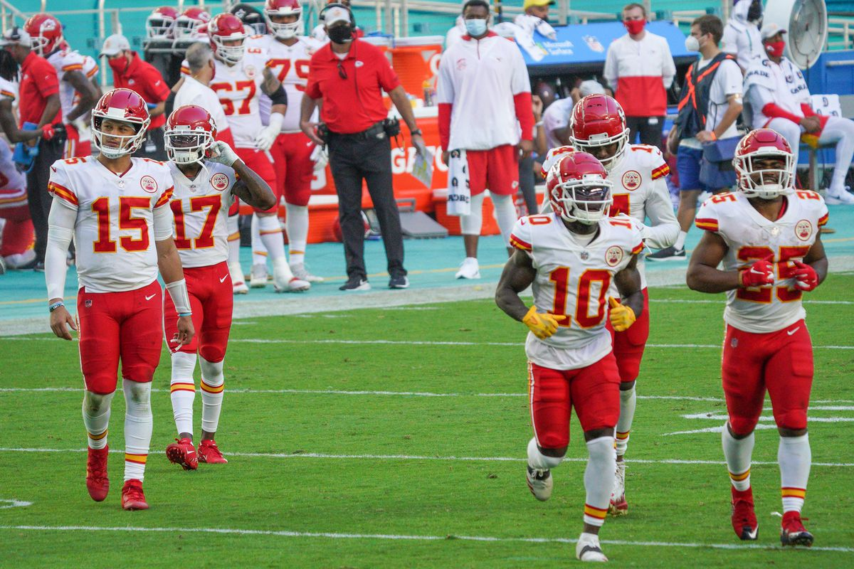 Patrick Mahomes #15 of the Kansas City Chiefs heads to the huddle during the game against the Miami Dolphins at Hard Rock Stadium on December 13, 2020 in Miami Gardens, Florida.