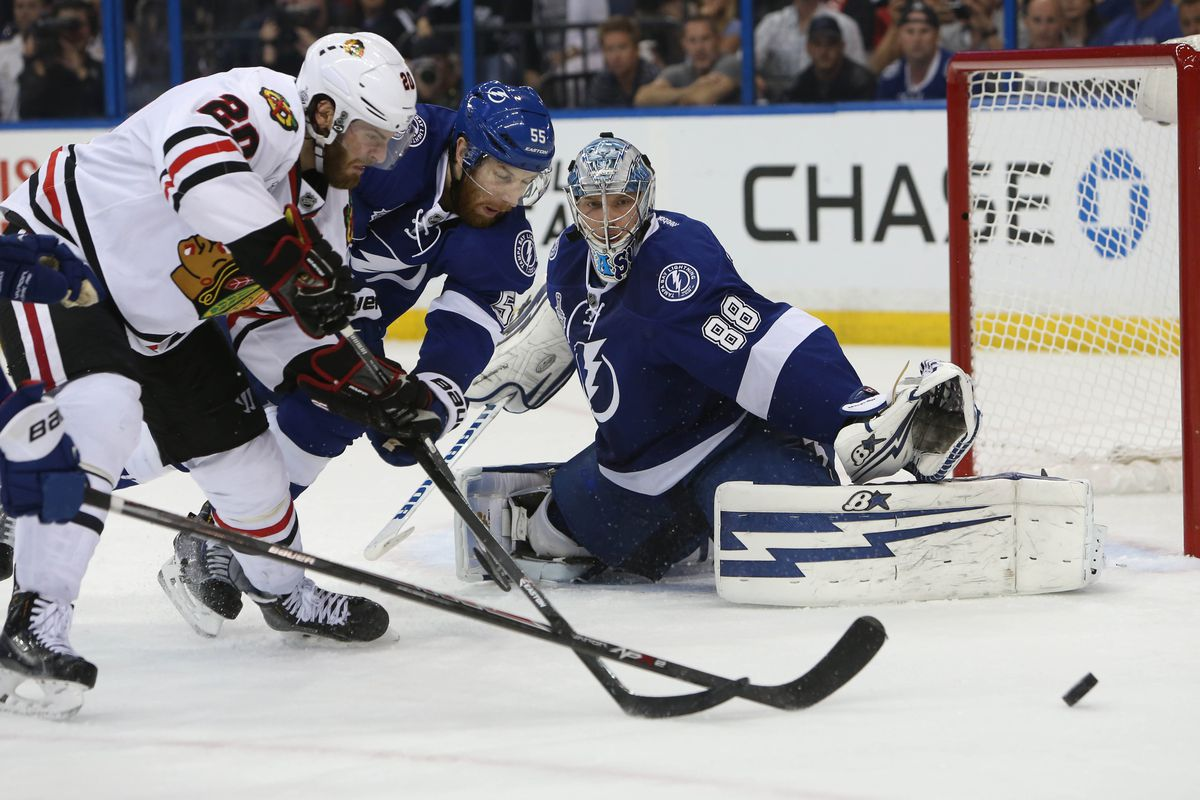 Lightning goalie Andrei Vasilevskiy watches teammate Braydon Coburn and Chicago's Antoine Vermette chase the puck in Tampa Bay's 4-3 win in Game 2 of the 2015 Stanley Cup Final Saturday night in Tampa.