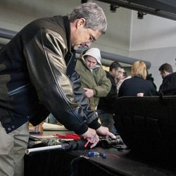 Patrick Wayne checks a hunting rifle at the South Towne Expo Center during the 2013 Rocky Mountain Gun Show, Saturday, Jan. 5, 2013.