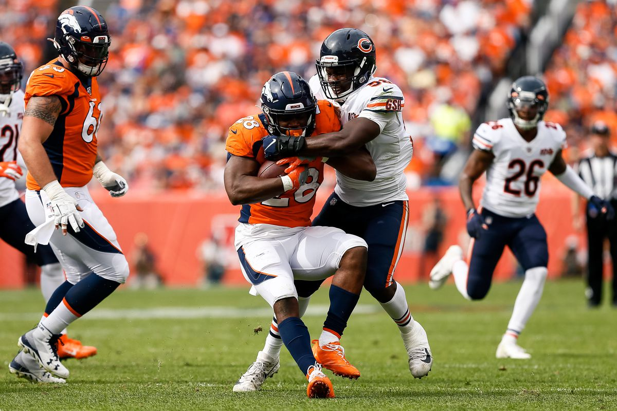Chicago Bears linebacker Roquan Smith tackles Denver Broncos running back Royce Freeman in the second quarter at Empower Field at Mile High.