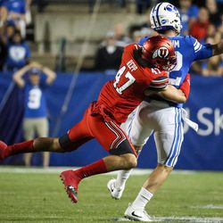 Utah Utes defensive end Caleb Repp (47) tackles Brigham Young Cougars quarterback Tanner Mangum (12), leading to an incomplete pass, at LaVell Edwards Stadium in Provo on Saturday, Sept. 9, 2017.