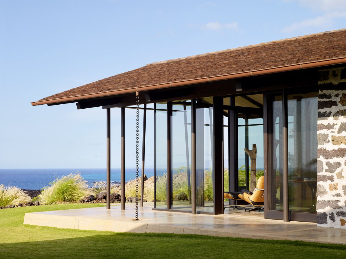 Exterior of home with ocean in background.