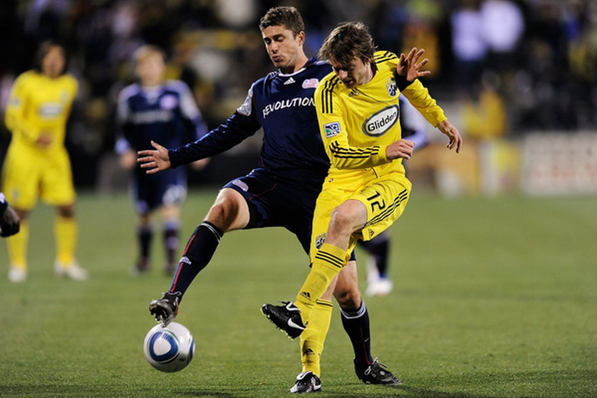 COLUMBUS, OH - MAY 8:  Chris Tierney #8 of the New England Revolution and Eddie Gaven #12 of the Columbus Crew battle for control of the ball on May 8, 2010 at Crew Stadium in Columbus, Ohio.  (Photo by Jamie Sabau/Getty Images)