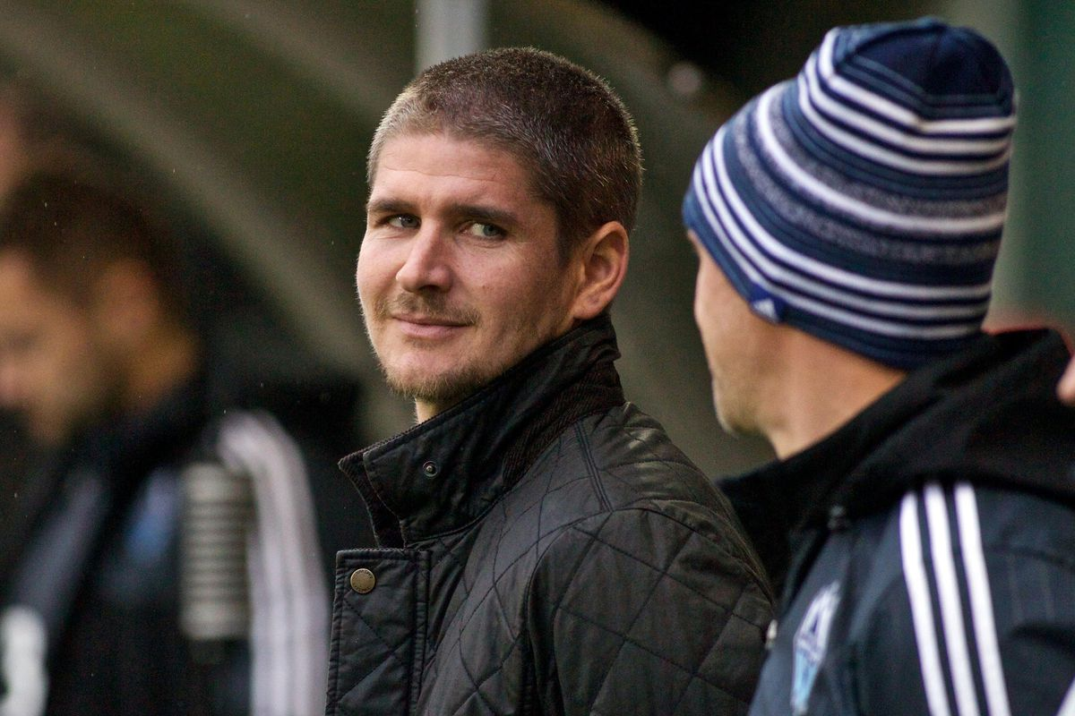 Hmm, is that a smirk or a stare? Vancouver's Carl Robinson proves difficult to read