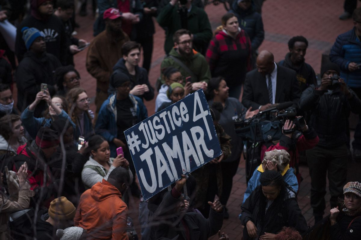 Minneapolis protesters demand justice for Jamar Clark after he was shot and killed by police.