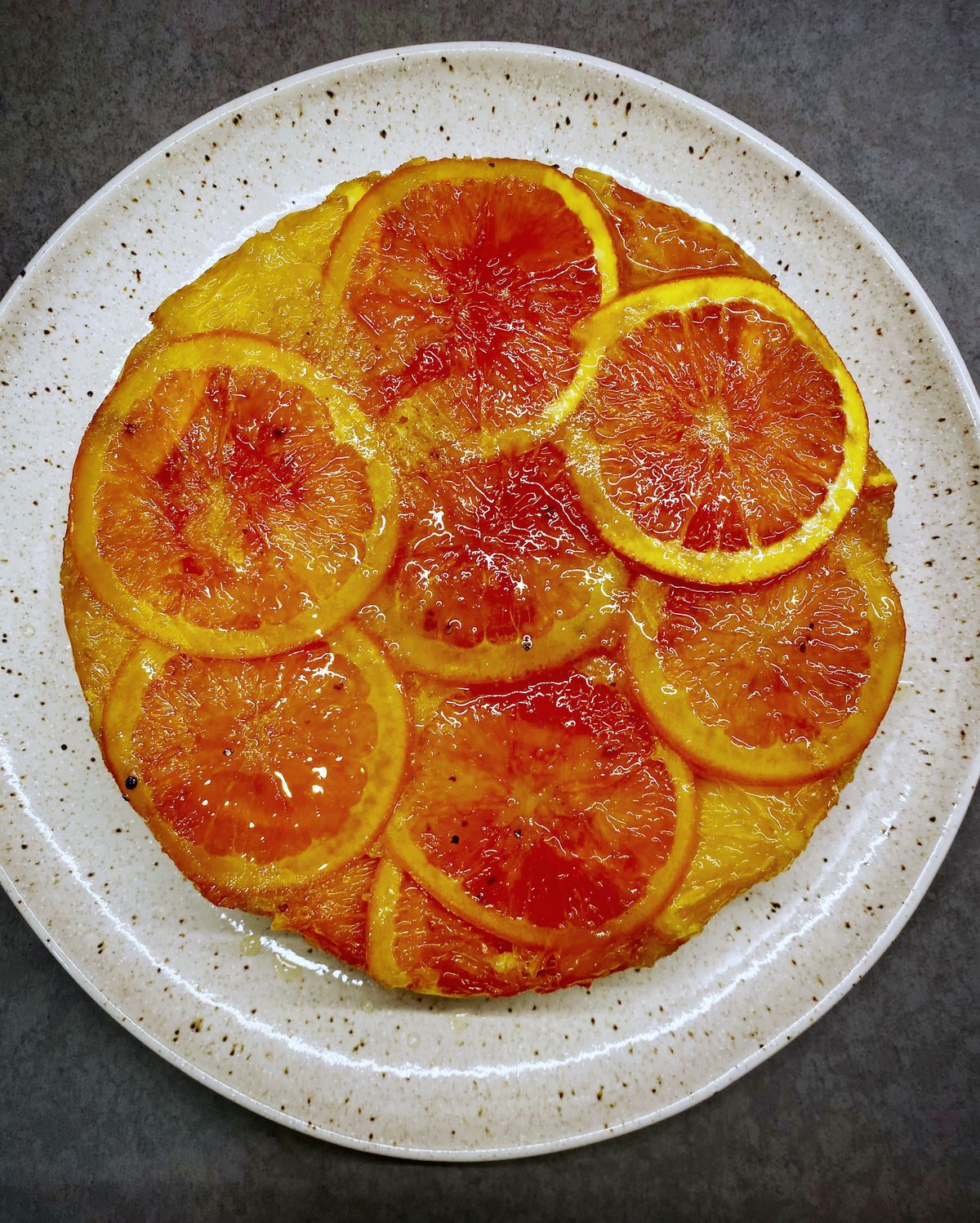 a cake with orange slices on top
