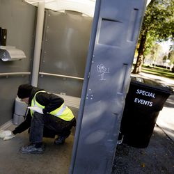 Paul Weller cleans a porta-potty in Pioneer Park in Salt Lake City on Wednesday, Sept. 28, 2016. Weller makes $9 an hour to clean and patrol the bathrooms that are used primarily by the homeless people who congregate in the park. Bathroom patrons are allowed to use them for four minutes, after which Weller asks them to leave. Drug use in the bathrooms has decreased somewhat since the four-minute time limit was instituted, but Weller still finds discarded drug paraphernalia in the toilets.