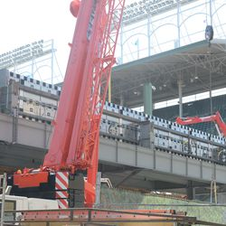 2:38 p.m. Left-field video board temporarily set on top of the bleachers -