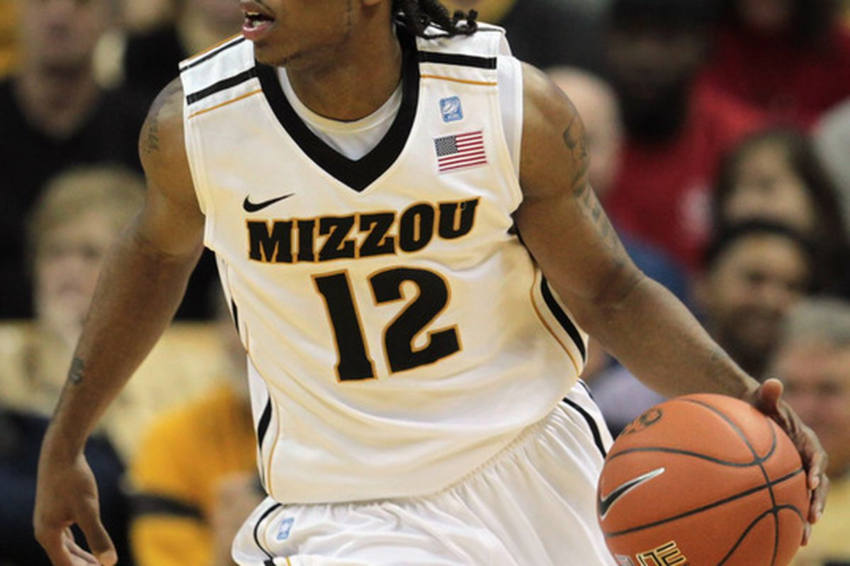 COLUMBIA MO - DECEMBER 08:  Marcus Denmon #12 of the Missouri Tigers controls the ball during overtime of the game against of the Vanderbilt Commodores on December 8 2010 at Mizzou Arena in Columbia Missouri.  (Photo by Jamie Squire/Getty Images)
