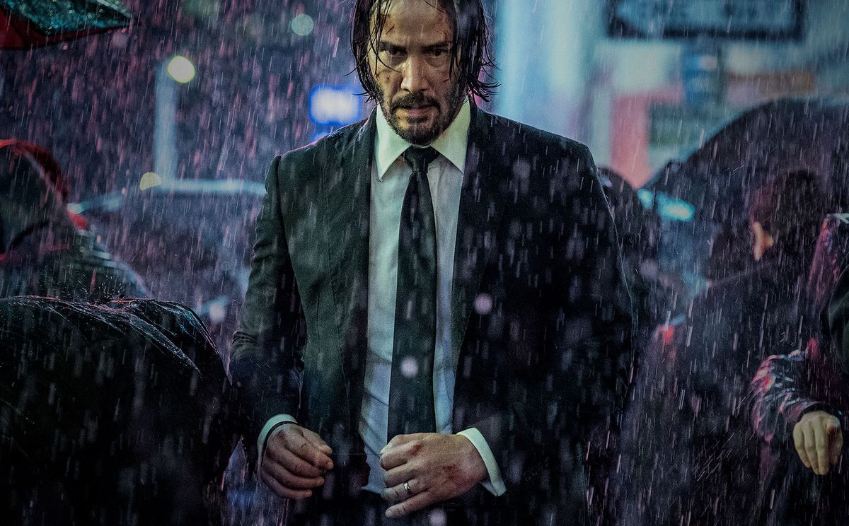 John Wick walks in the rain in a still from John Wick: Chapter 3 — Parabellum