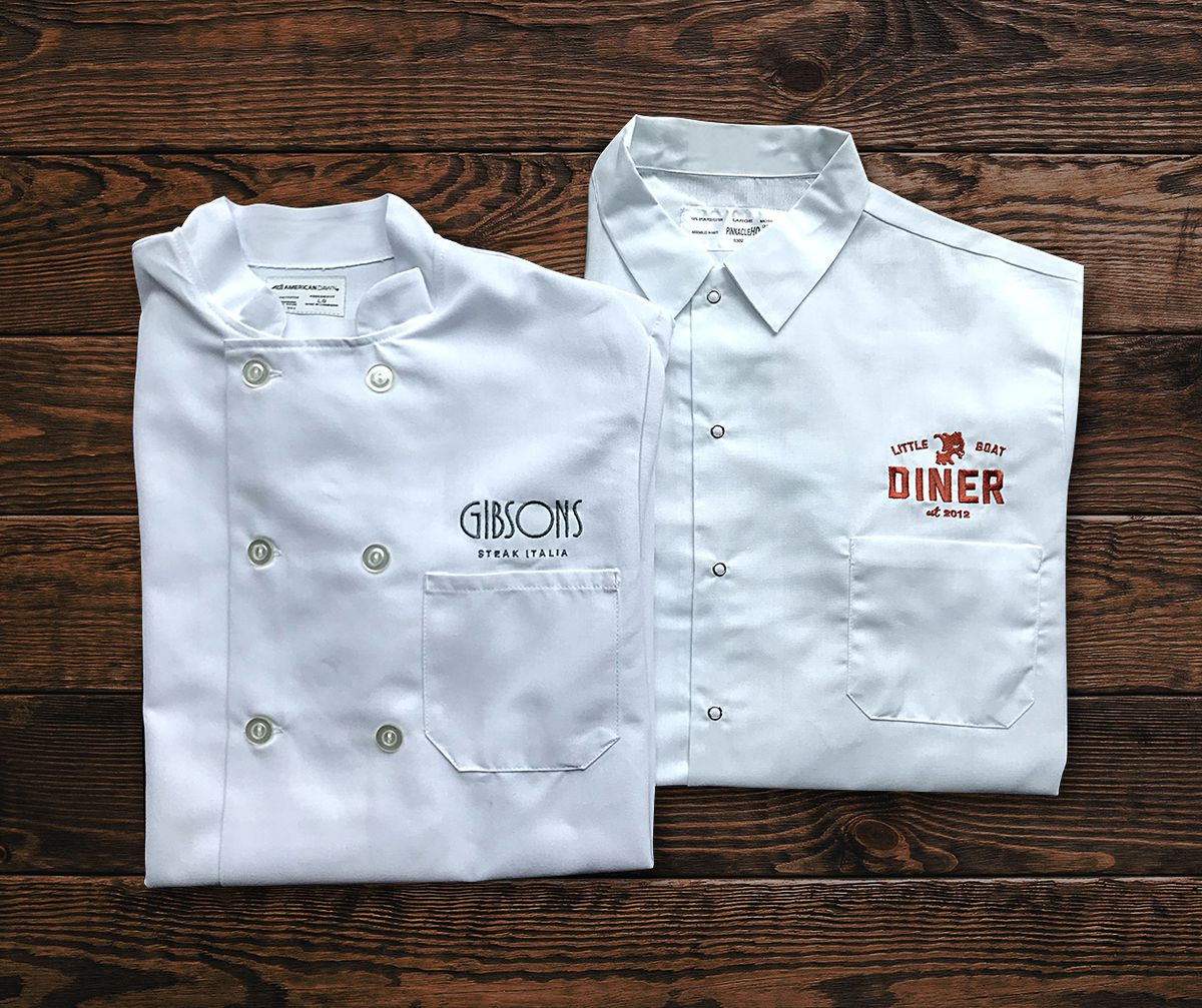Two chef shirts folded.
