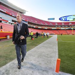 BYU Director of Athletics Tom Holmoe, walks on the field at Arrowhead Stadium prior to a game with Missouri in Kansas City Missouri Saturday, Nov. 14, 2015.