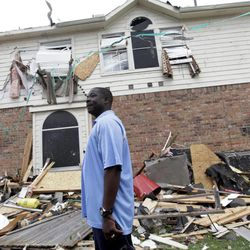 """Charles Paige stands amongst tornado debris as he surveys the damage to his home Wednesday, April 4, 2012, in Forney, Texas. The mayor of Forney, Texas, says it's """"a real blessing"""" that nobody was killed in the community by the tornadoes that ripped through parts of the Dallas area yesterday"""