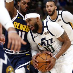 Utah Jazz guard Mike Conley (10) drives into Denver Nuggets guard Monte Morris (11) as the Utah Jazz and the Denver Nuggets play an NBA basketball game at Vivint Arena in Salt Lake City on Wednesday, Feb. 5, 2020.