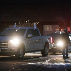 Vehicles with menorahs on their roofs head off for a Hanukkah paradethrough Salt Lake City on Sunday, Dec. 13, 2020. The event was organized byChabad Lubavitch of Utah.