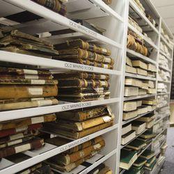 Old mining books sit on shelves inside the vault of the Salt Lake County Recorder's Office in Salt Lake City on Monday, June 5, 2017.