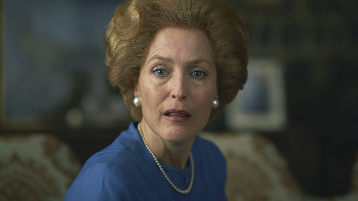 Gillian Anderson as Margaret Thatcher on The Crown, sitting mouth agape
